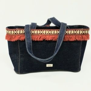 XOXO Denim Bag with red Fringe around the top.